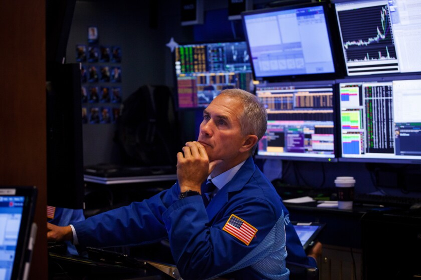 A trader works on the floor of the New York Stock Exchange (NYSE) in New York, U.S., on Monday, Sept. 10, 2018. Stocks held early gains even as shares of Apple and Asia-based suppliers slumped after President Donald Trump insisted his trade war with China will spur more manufacturing jobs in the U.S. Photographer: Michael Nagle/Bloomberg