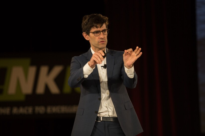 Nicholas Thompson, editor-in-chief of Wired magazine, speaking at the 2018 CO-OP THINK Conference in Chandler, Ariz.