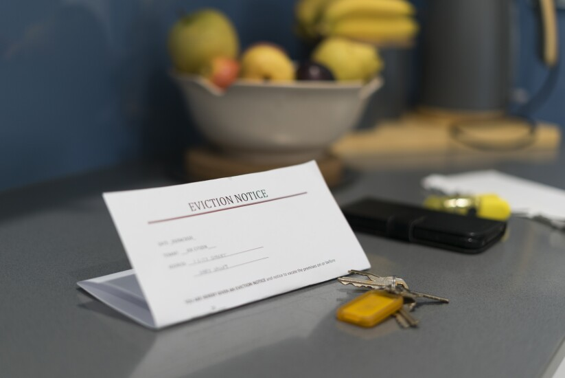 An eviction notice sitting on kitchen counter.