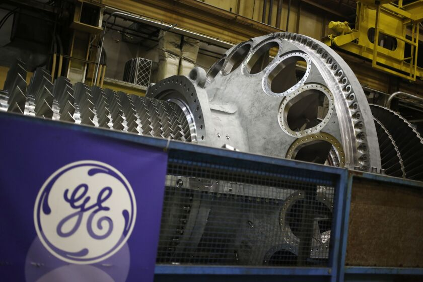 General Electric steam turbine logo pension defined benefits plan Bloomberg News