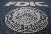 An FDIC seal woven into carpet.