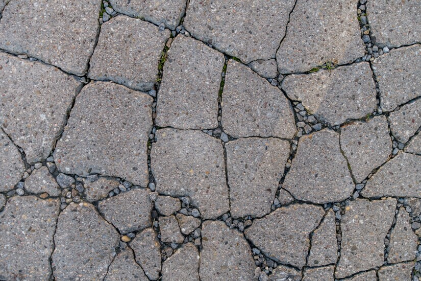 asphalt-cracked-128536820-adobe.jpeg