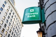 Signage is displayed outside a Citizens Financial bank branch in downtown Boston.