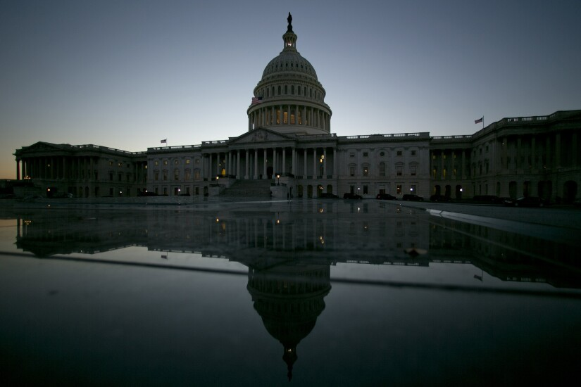 The U.S. Capitol building is reflected in Washington, D.C.