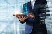 Businessman using tablet analyzing data.