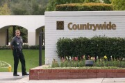 A security guard stands outside the Countrywide Financial Corp. headquarters in Calabasas, California on Wednesday, October 20, 2004.