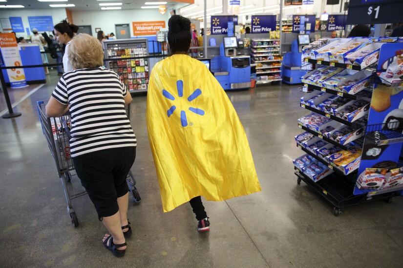 Walmart employee wearing a cape