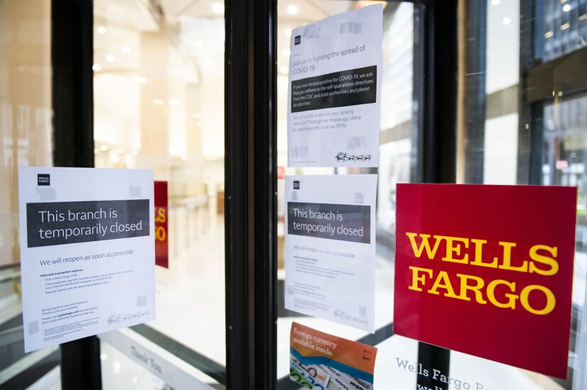 A temporarily closed sign is displayed in the window of a Wells Fargo branch in an effort to stem the spread of COVID-19 in New York on April 10, 2020.