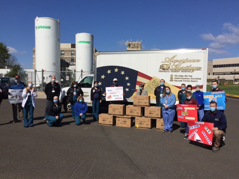Heritage Federal Credit Union employees deliver personal protective equipment to a local hospital.