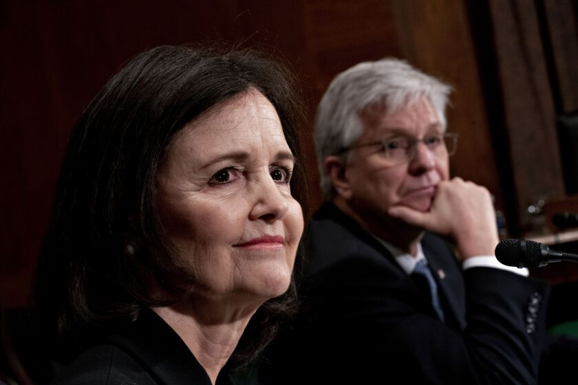 Judy Shelton testified along with Christopher Waller, research director of the Federal Reserve Bank of St. Louis, after the Trump administration announced plans last month to nominate both to open seats on the Fed board.