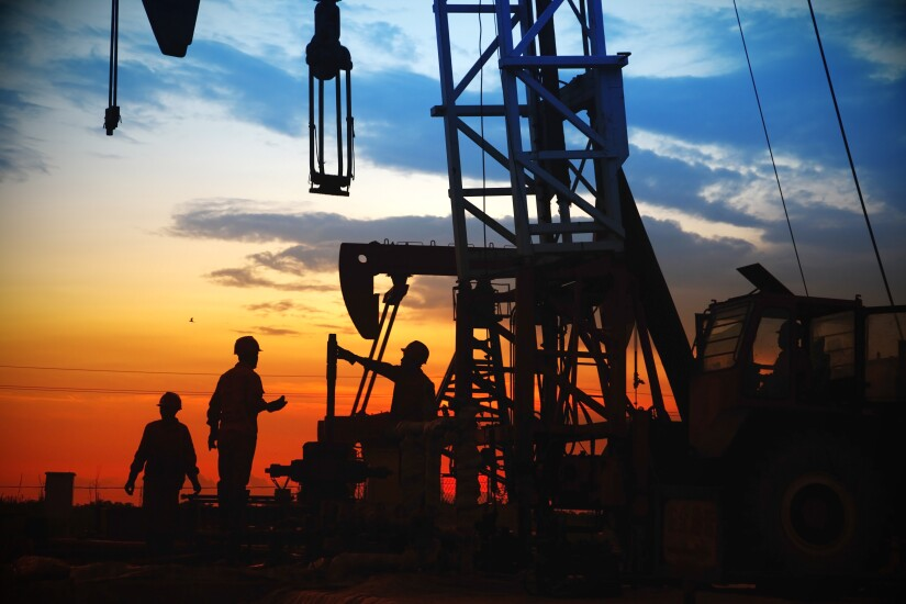 oil field, the oil workers are working; used in item about C&I lending