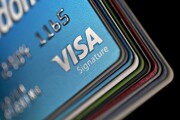 A Visa credit card is arranged for a photograph with other credit cards.