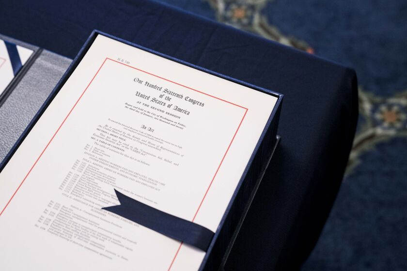 The CARES Act includes a direct payment to most taxpayers and their families. (Bloomberg News)
