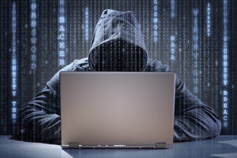 Hooded computer hacker.
