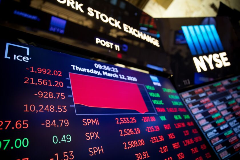 Traders On The Floor Of The NYSE As Trump's Speech Spooks Investors 3/12/20