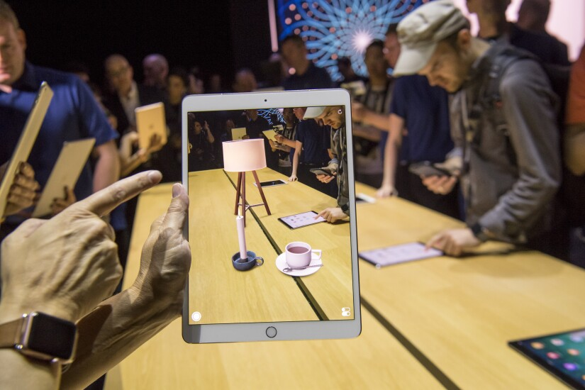 Apple's ARKit creates a lamp and coffee cup