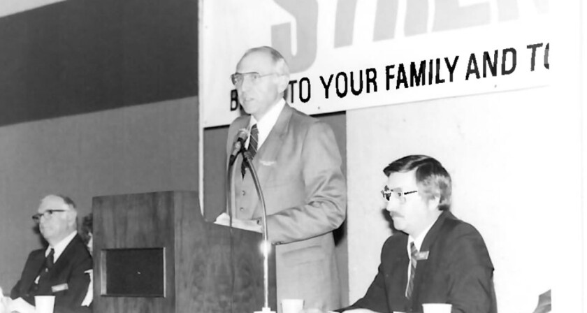 Calvin Phillips, center, speaking during a Dallas Postal CU annual meeting