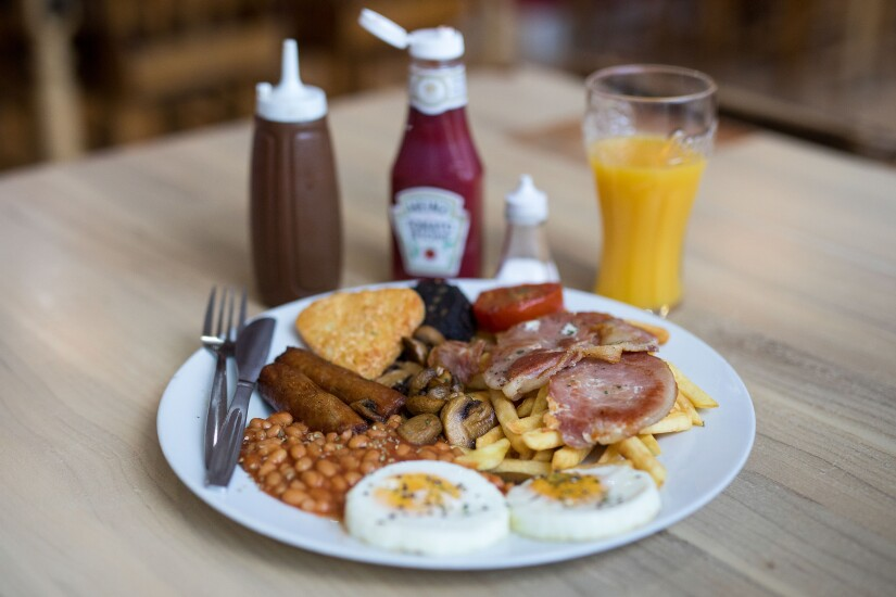 Sausages, eggs, baked beans, hash browns, orange juice, coffee, ketchup: The 'Super' full English breakfast sits at the 'Enough to Feed an Elephant' cafe in this arranged photograph in London, on July 10, 2017