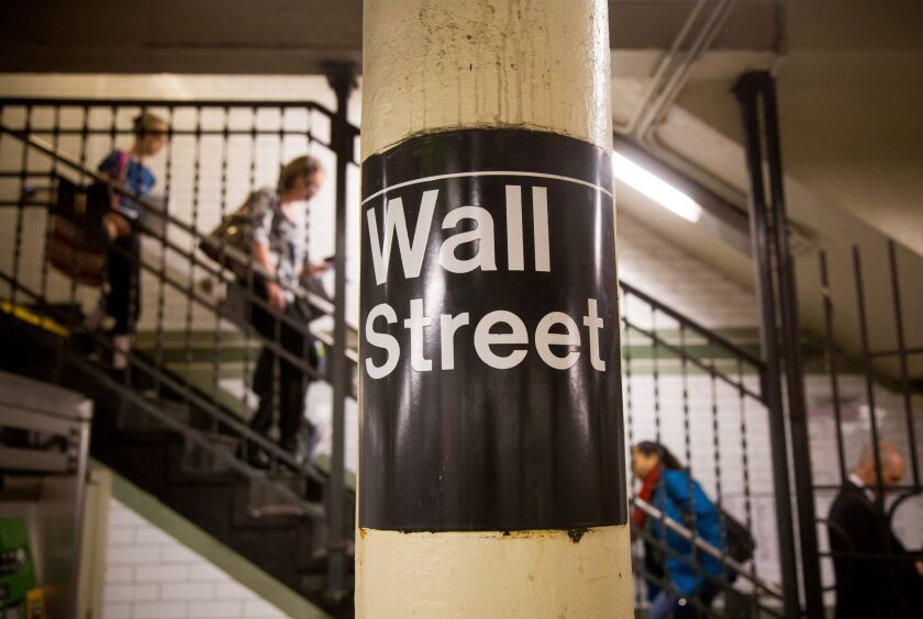 The Wall Street subway sign is seen in a station near the New York Stock Exchange (NYSE) in New York, U.S., on Friday, April 22, 2016. The Standard & Poor's 500 Index was little changed after retreating from a four-month high, as gains in oil lifted commodity producers to help offset weaker-than-forecast earnings from Microsoft Corp. and Google parent Alphabet Inc. Photographer: Michael Nagle/Bloomberg