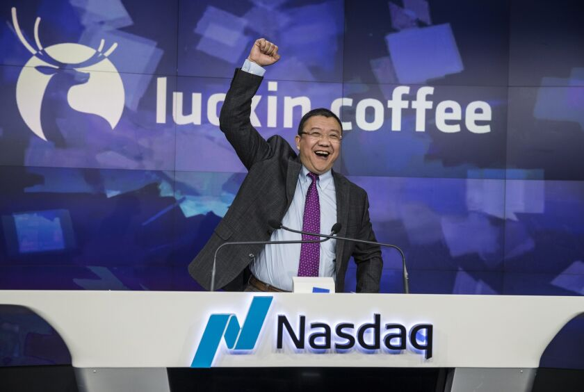 Charles Zhengyao Lu, chairman and founder of Luckin Coffee Inc., gestures while speaking during the company's IPO at the Nasdaq MarketSite in New York.