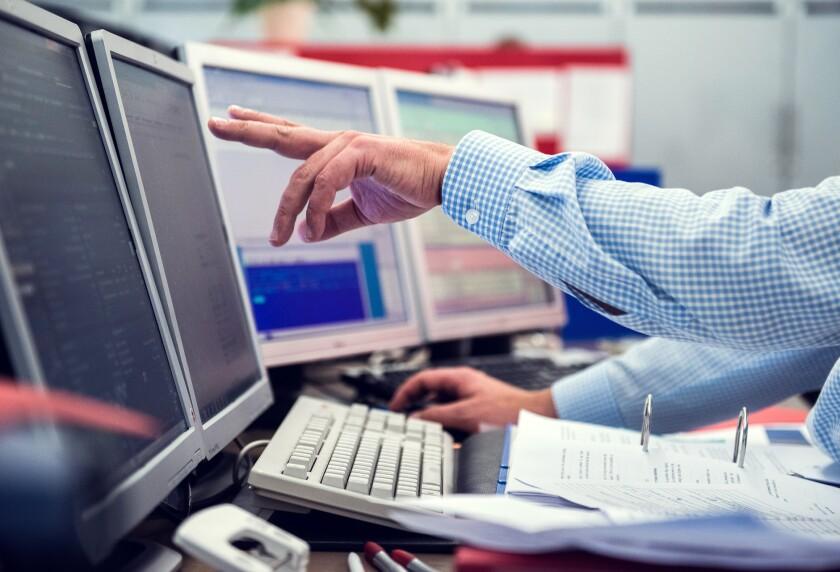 Brokers-traders-financial advisors-training-portfolio management-computers Bloomberg News