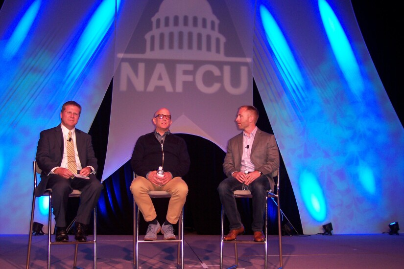 From left, Arkansas FCU President and CEO Rodney Showmar moderated a payments panel at the 50th annual NAFCU Annual Meeting, featuring Ben Colvin, SVP of North America enterprise security solutions for Mastercard (center), and Neil Mumm, VP of corporate strategy for Visa.