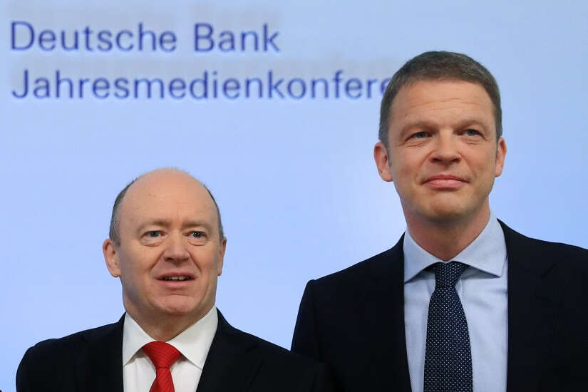 Christian Sewing, right, and John Cryan of Deutsche Bank, in February of 2017.