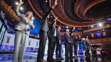 2020 Democratic presidential candidates Marianne Williamson, author, from left, John Hickenlooper, former governor of Colorado, Andrew Yang, founder of Venture for America, Pete Buttigieg, mayor of South Bend, former U.S. Vice President Joe Biden, Senator Bernie Sanders, an independent from Vermont, Senator Kamala Harris, a Democrat from California, Senator Kirsten Gillibrand, a Democrat from New York, Senator Michael Bennet, a Democrat from Colorado, and Representative Eric Swalwell, a Democrat from California, stand on stage during the Democratic presidential candidate debate in Miami.