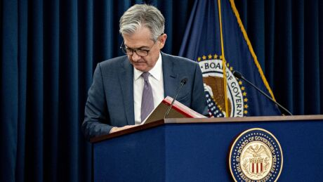 Jerome Powell, chairman of the Federal Reserve, exits after speaking during a news conference in Washington on March 3, 2020.