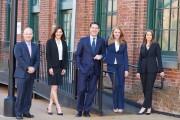 A photo of the team at Seyle Hickey Wealth Management. From left: Tim Hickey, Kristin DeLong, Rusty Seyle, Alison Ehret, Marisa Gurnari. Photo courtesy Raymond James.