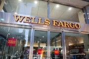 Signage displayed at a Wells Fargo bank branch in New York.