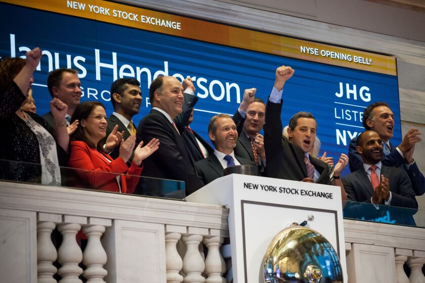While outflows have peaked in the first quarter, Janus Henderson CEO Richard Weil, center left, said gross sales reached the highest since the merger, and that redemptions slowed in April.