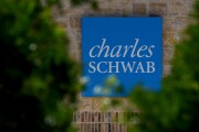 Signage is displayed outside a Charles Schwab Corp. location in San Antonio, Texas, U.S., on Sunday, July 15, 2018. Charles Schwab Corp. is scheduled to release earnings figures on July 17. Photographer: Callaghan O'Hare/Bloomberg