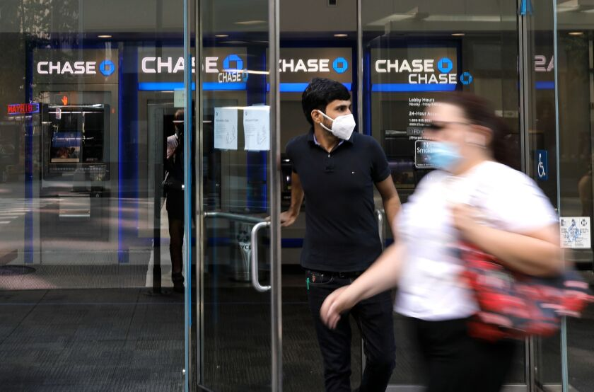 Branch managers are now in the uncomfortable position of trying to balance the health of employees and customers against longstanding concerns that face masks are a security risk. Face coverings have traditionally been banned inside branches to deter robberies.