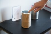 An attendee operates the new Amazon.com Inc. Echo device on display during the company's product reveal launch event in downtown Seattle, Washington, U.S., on Wednesday, Sept. 27, 2017. Amazon unveiled a smaller, cheaper version of its popular Alexa-powered Echo speaker that the e-commerce giant said has better sound. Photographer: Daniel Berman/Bloomberg