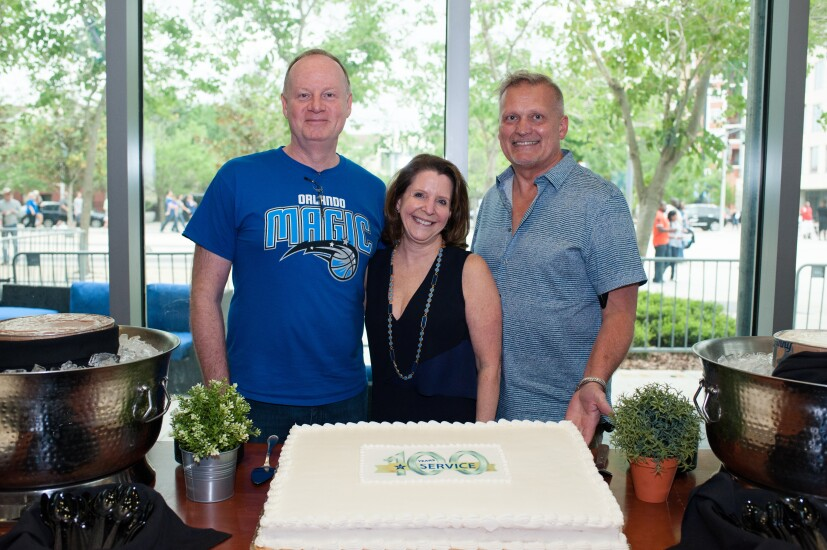 Fairwinds CU leaders celebrating a combined 100 years of service. From left to right: Larry Tobin (president/CEO), Kathy Chonody (CFO) and Phil Tischer (COO).