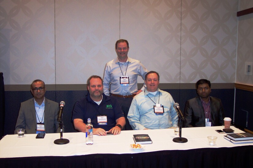 AI panel at the 2018 NACUSO annual conference. From L-R: Rojin Nair, Celero Solutions, John Best, Best Innovation Group, Scott Daukas, TwinStar CU, Srinivas Njay, Payjo. Standing behind Brian Lauer, partner with Messick, Lauer & Smith, moderator