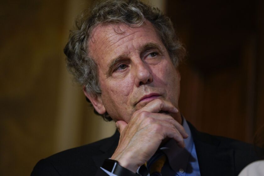 """""""My legislation would allow every American to set up a free bank account so they don't have to rely on expensive check cashers to access their hard-earned money,"""" said Sen. Sherrod Brown, an Ohio Democrat."""