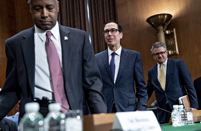 Ben Carson, secretary of Housing and Urban Development (HUD), from left, Steven Mnuchin, U.S. Treasury secretary, and Mark Calabria, director of the Federal Housing Finance Agency (FHFA), arrive to a Senate Banking Committee hearing in Washington, D.C., U.S., on Tuesday, Sept. 10, 2019. President Donald Trump's point men on housing finance are looking to sell lawmakers on their plan for freeing Fannie Mae and Freddie Mac.