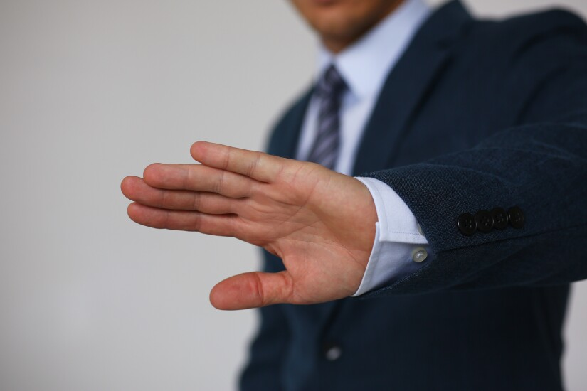 Stock image of a hand gesture that says no, decline reject.