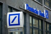 Deutsche Bank signage sits on the side of a branch in Hamburg, Germany.