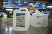 Five litre bottles of 70% hand sanitizing gels sit on the production line at Cleenol Group Ltd.'s factory in Banbury, U.K., on Friday, March 6, 2020. The stockpiling crisis that has hit supermarkets across Asia has spread to Europe as consumers start hoarding groceries and hygiene products amid fears of a coronavirus pandemic. Photographer: Chris Ratcliffe/Bloomberg
