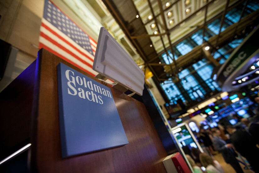 Goldman Sachs signage is displayed at the company's booth on the floor of the New York Stock Exchange.