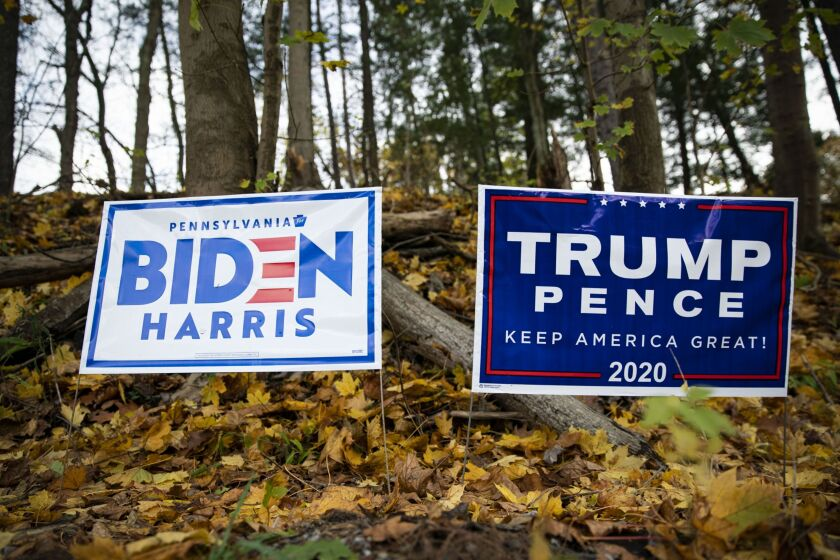Campaign signs in support of Joe Biden, 2020 Democratic presidential nominee, and U.S. President Donald Trump in Pittsburgh, Pennsylvania, U.S., on Sunday, Nov. 1, 2020. After striding into the 2020 election year with a white-hot economy and beating Democratic efforts to remove him from office, Trump was ready to cruise to a second term. But then came the coronavirus pandemic and economic devastation. Photographer: Al Drago/Bloomberg