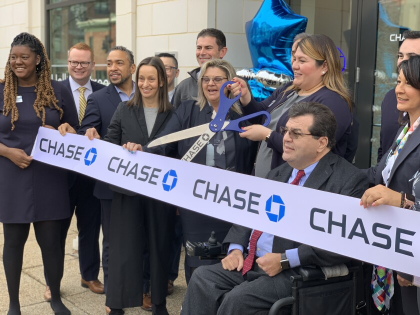Diana Jimenez, branch manager of the Chase bank branch near Gallaudet University, cutting the ribbon