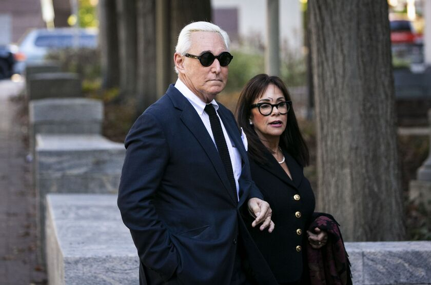 Roger Stone, former adviser to Donald Trump's presidential campaign, and his wife Nydia Stone arrive at federal court in Washington, D.C.