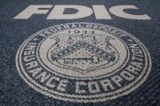 An FDIC seal woven into carpet.