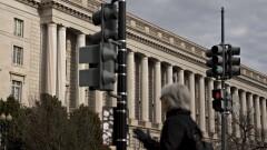 A pedestrian walks past the IRS headquarters in Washington, D.C.