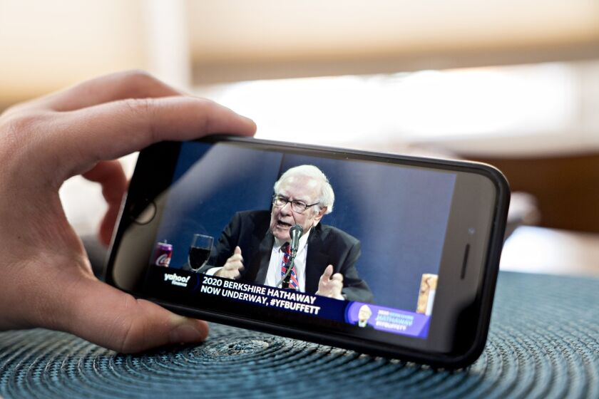 Warren Buffett, chairman and CEO of Berkshire Hathaway, speaks during the company's virtual annual shareholders meeting seen on a smartphone on May 2, 2020.