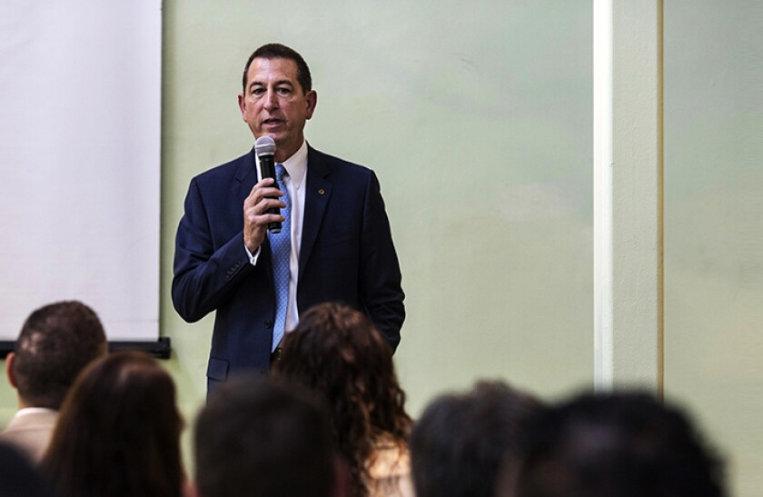 Comptroller of the Currency Joseph Otting speaks to attendees of a bus tour organized to highlight Community Reinvestment Act supported projects in the Jamaica, Queens neighborhood of Queens, NY, U.S., on Wednesday August 21, 2019. The tour highlighted challenges in low to moderate income neighborhoods for bankers, activists, and non profit workers.